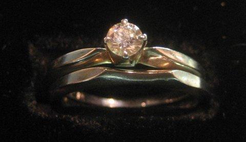 18 Kt. white gold wedding set with round diamond