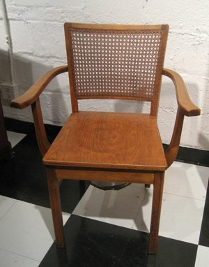 Mixed wood potty chair with lift top seat & caned back
