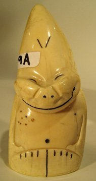Carved ivory whale tooth decorated with happy face