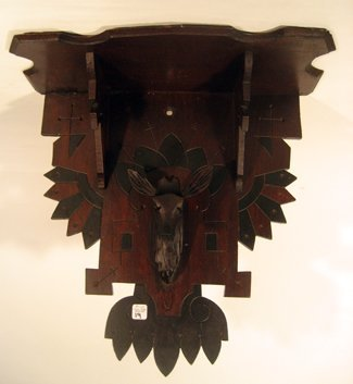Carved wooden wall shelf decorated with deer's head