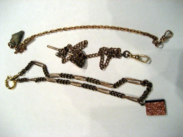Three miscellaneous watch chains with fobs
