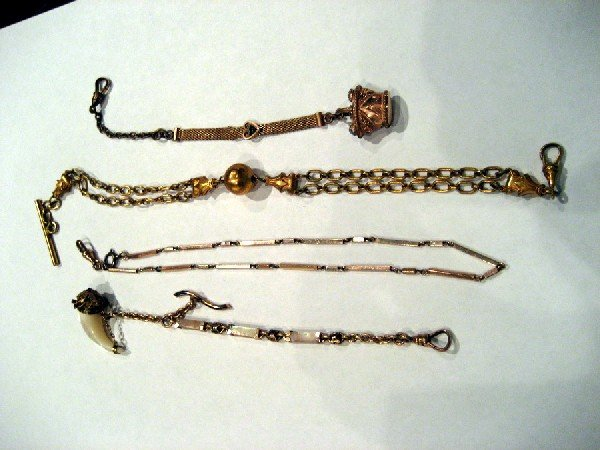 Four miscellaneous watch chains - three with fobs