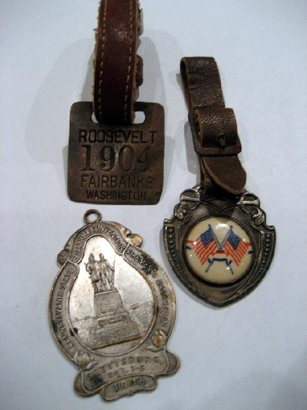 Three pocket watch fobs - two on leather bands.