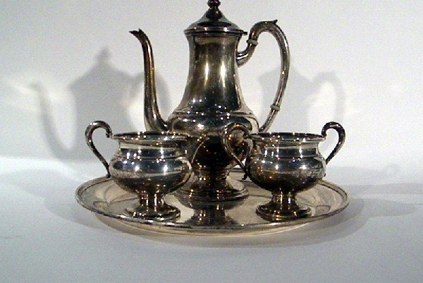 Sterling Silver Teaset: teapot, sugar, creamer, and rou