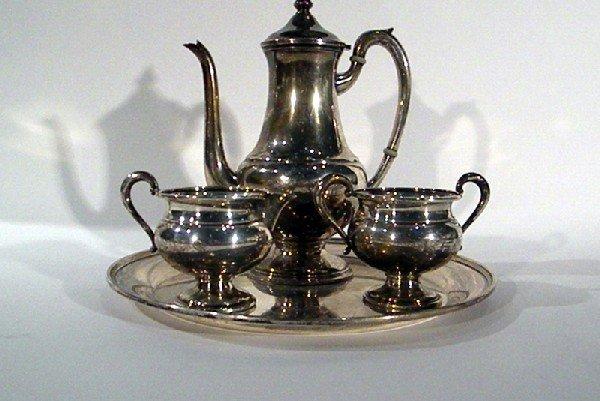 Sterling Silver Teaset: teapot, sugar, creamer, and rou