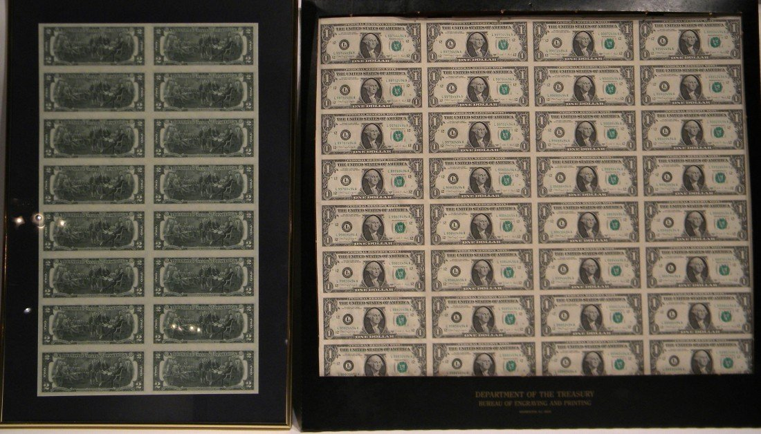 2 Framed uncut U.S. currency sheets