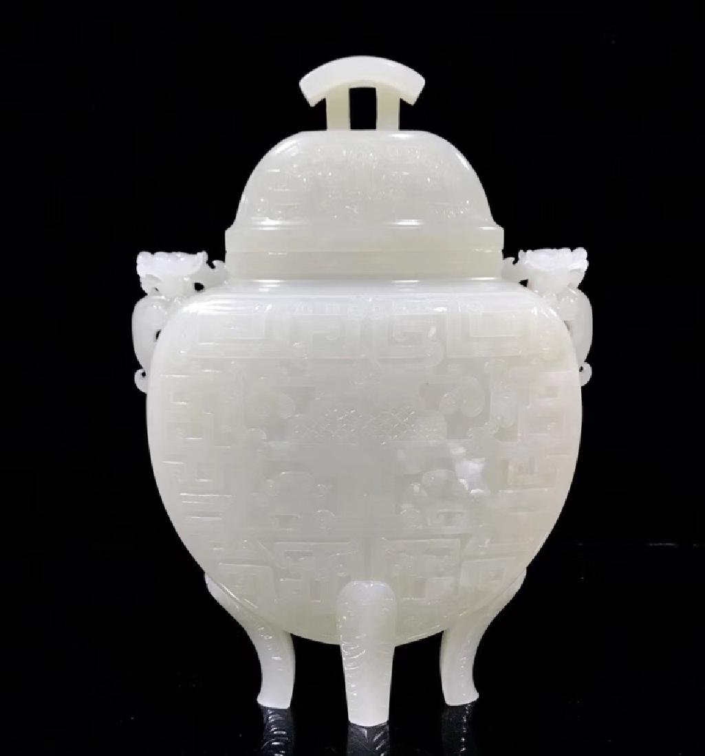 A CARVED WHITE JADE VASE AND COVER , QING DYNASTY
