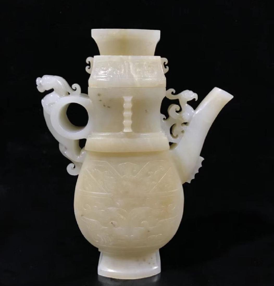 A CARVED WHITE JADE EWER , QING DYNASTY