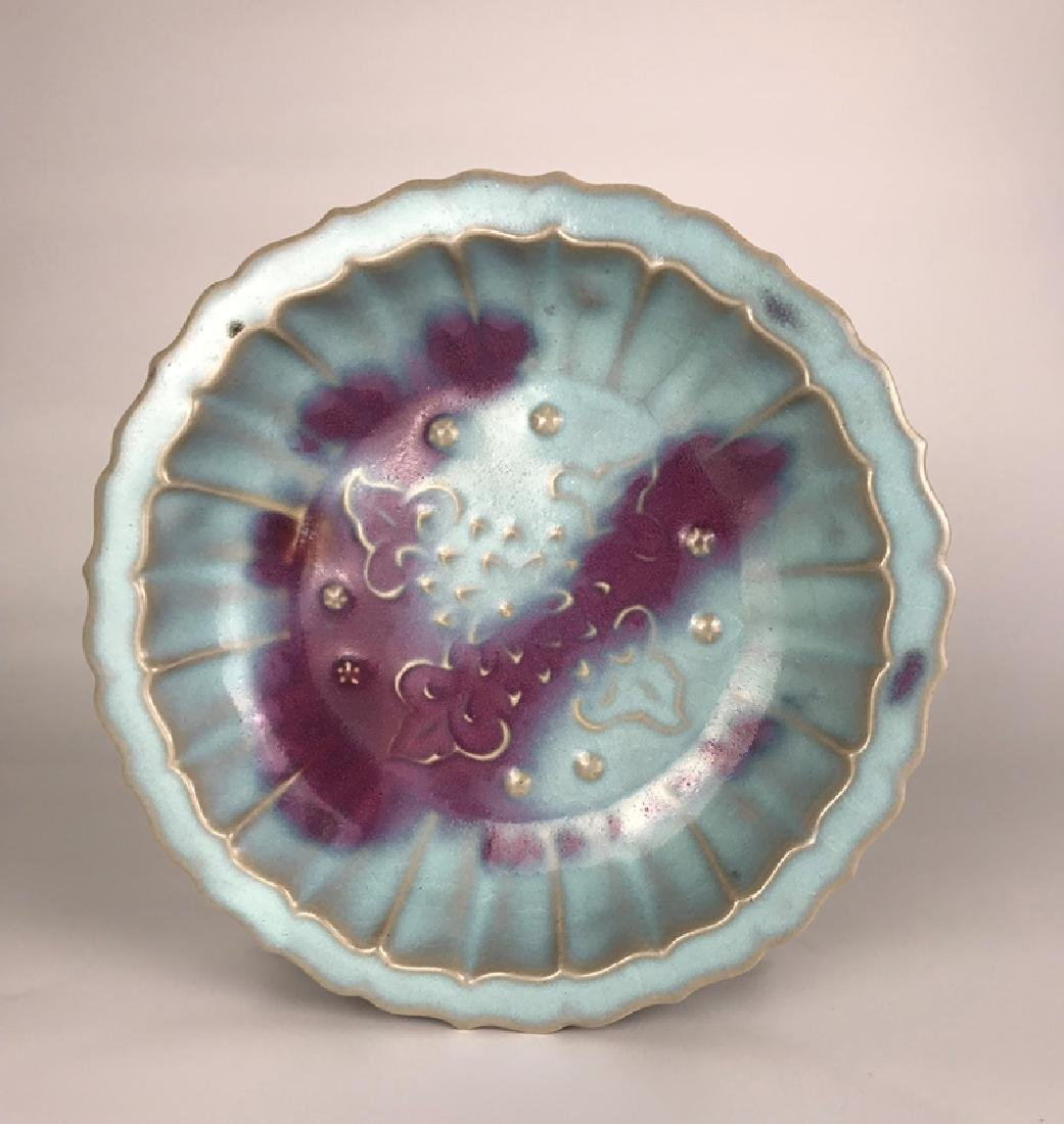 A CARVED JUNYAO DISH , MING DYANSTY