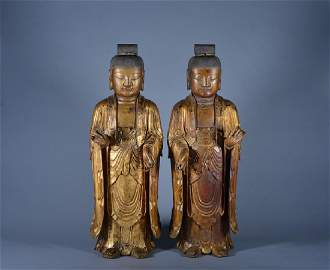 A PAIR OF GILT-LACQUER WOOD BUDDHAS , QING DYNASTY