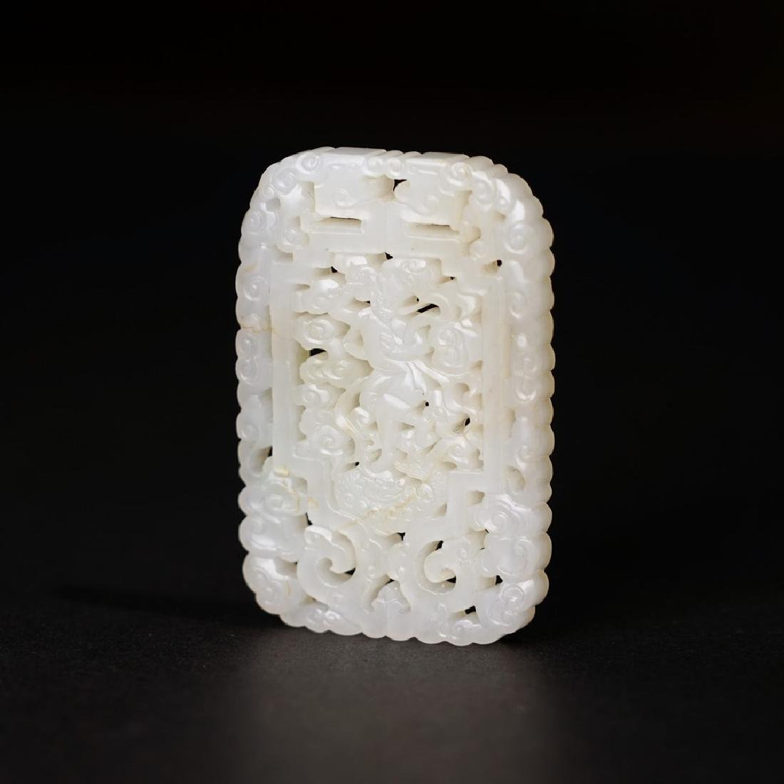 A CARVED WHITE JADE 'FIGURE' PENDANT ;QING DYNASTY