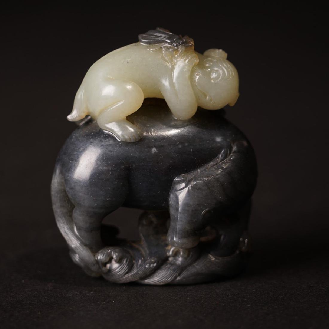 A CARVED RUSSET JADE 'HORSE AND MONKEY' GROUP ,QING