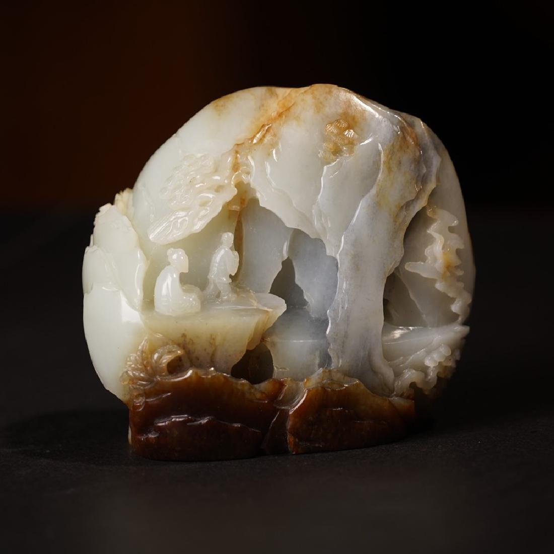 A CARVED RUSSET JADE 'LANDSCAPE' MOUNTAIN ,QING DYNASTY