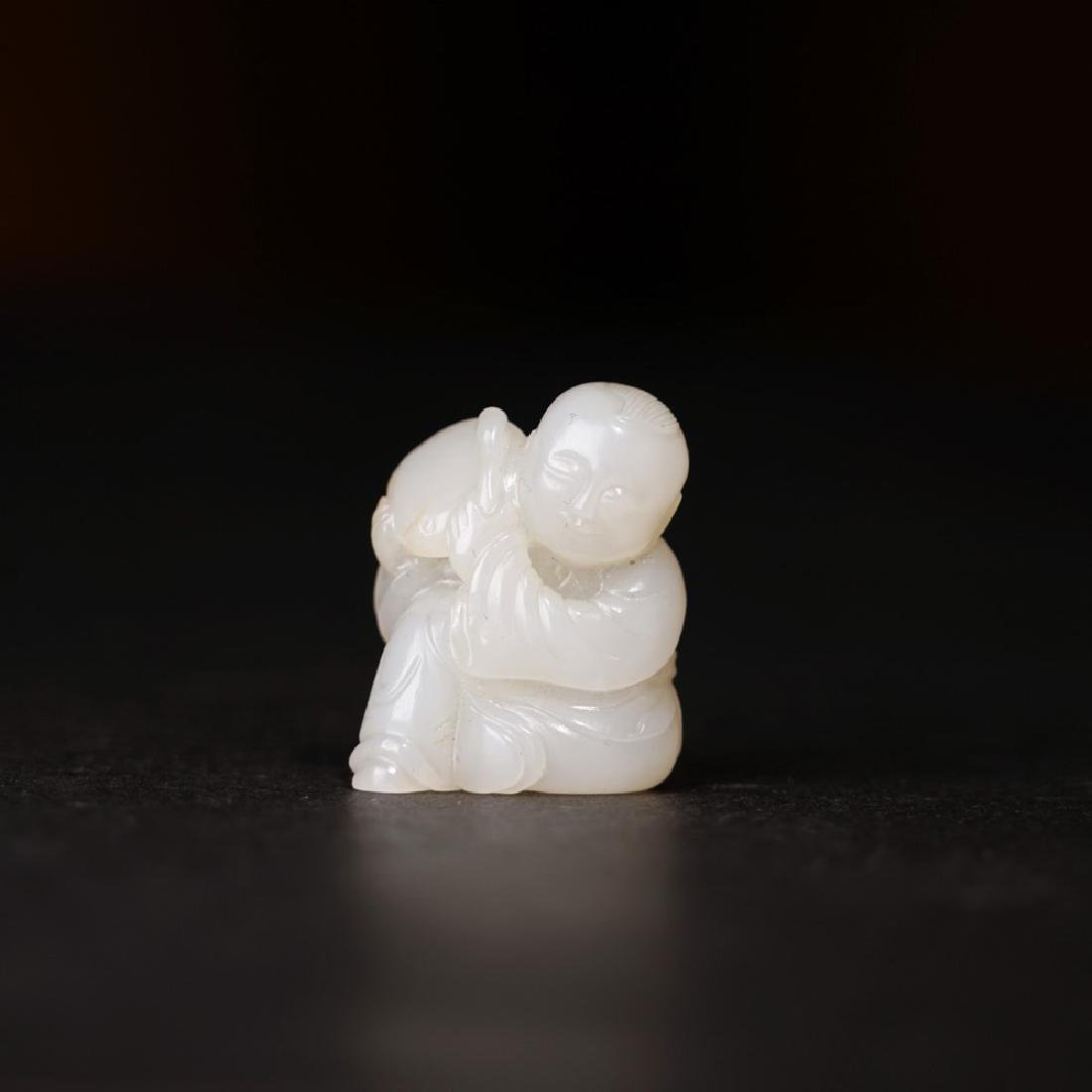 A CARVED WHITE JADE BOY ,QING DYNASTY