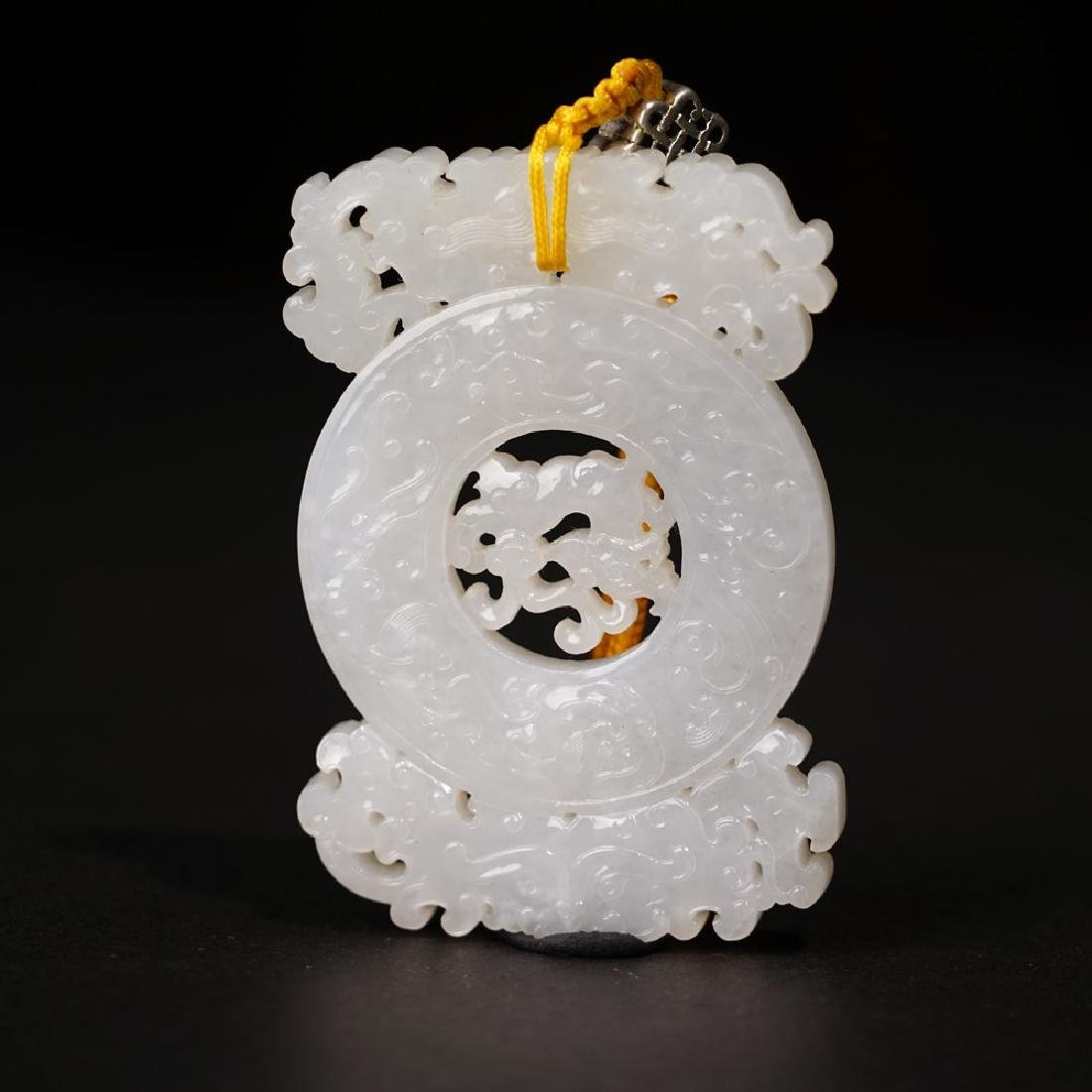 A CARVED WHITE JADE 'DRAGON' PENDANT ,QING DYNASTY