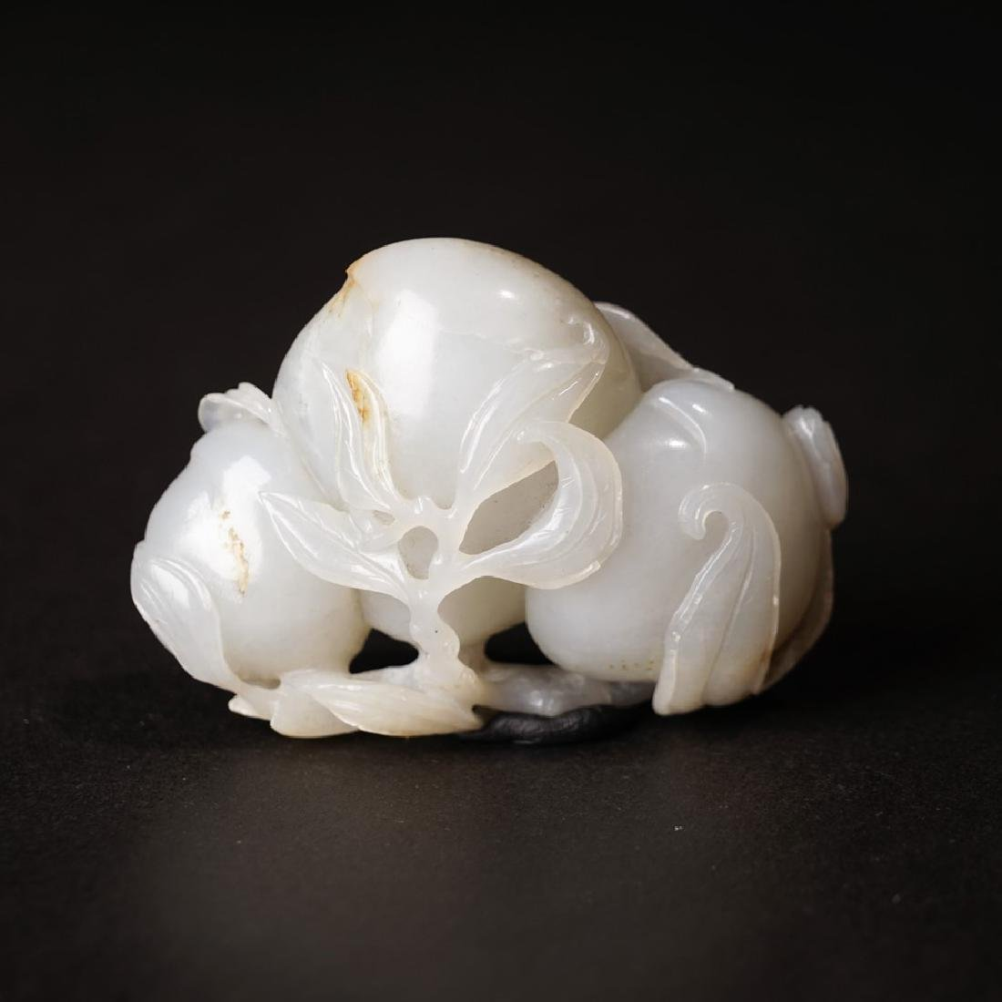 A CARVED WHITE JADE 'PEACH' GROUP ,QING DYNASTY