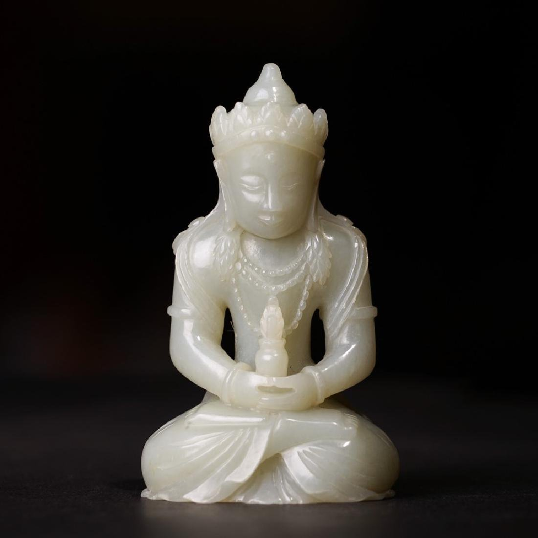 A CARVED WHITE JADE AMITAYUS ,QING DYNASTY