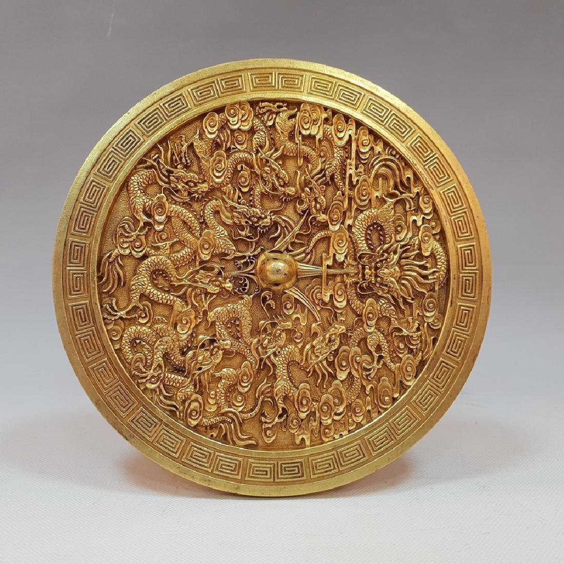 A CARVED GILT-GOLD DRAGON BOX AND COVER ,TANG PERIOD