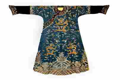 AN EMBROIDERED BLUE SILK 'DRAGON' ROBE.QING PERIOD