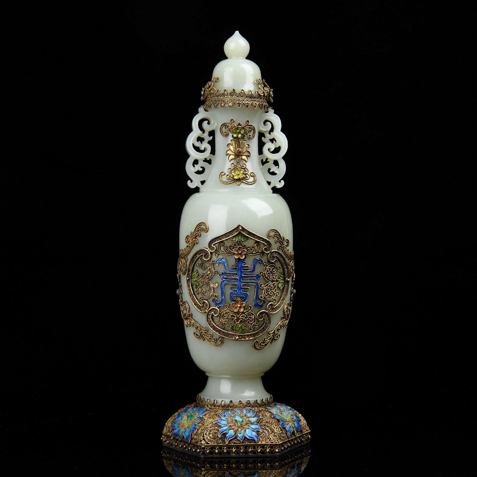 A CARVED WHITE JADE VASE AND COVER