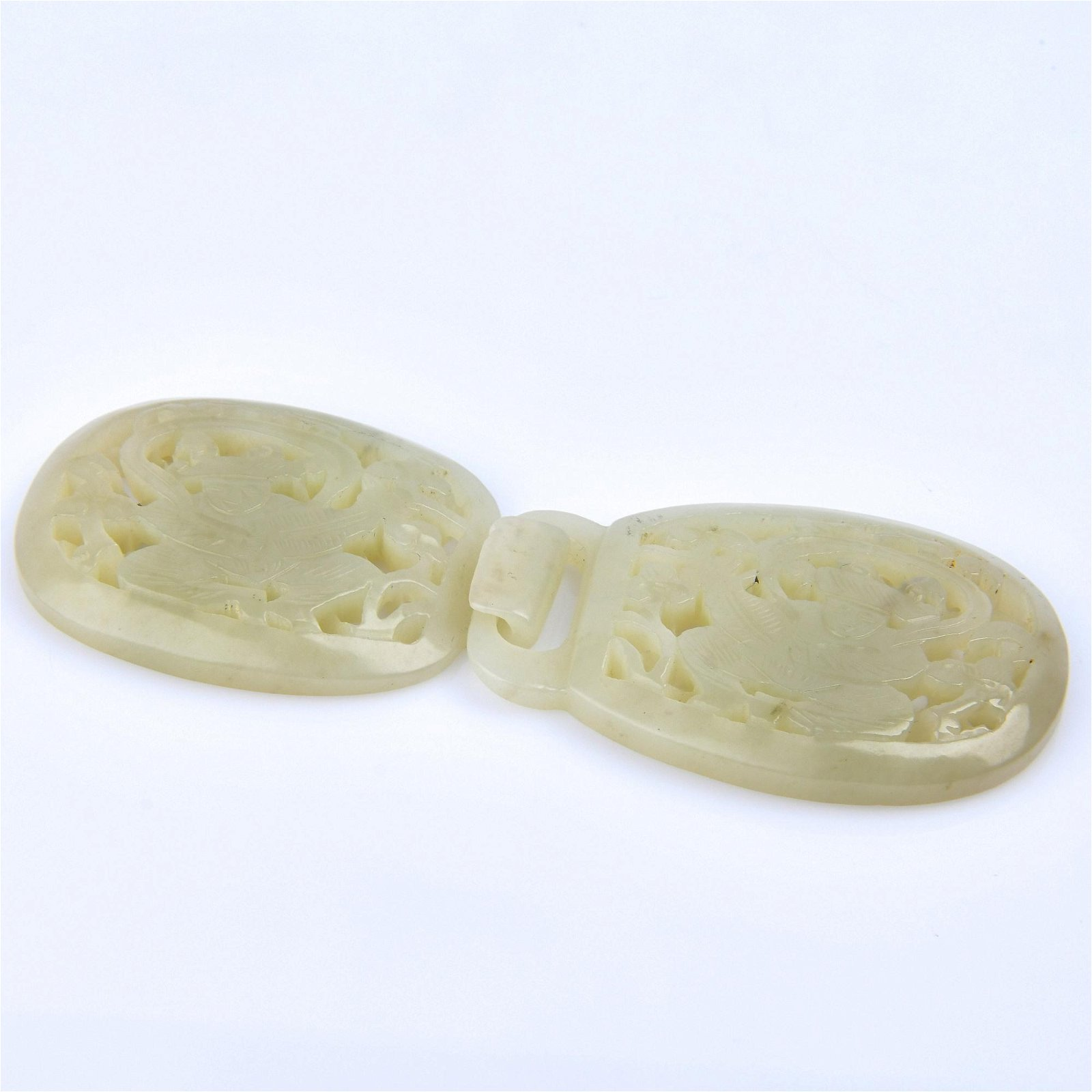 A CARVED WHITE JADE BELT-HOOK.QING PERIOD