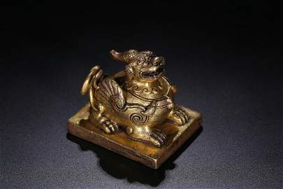 A GILT-BRONZE 'BEAST' SEAL.QING PERIOD