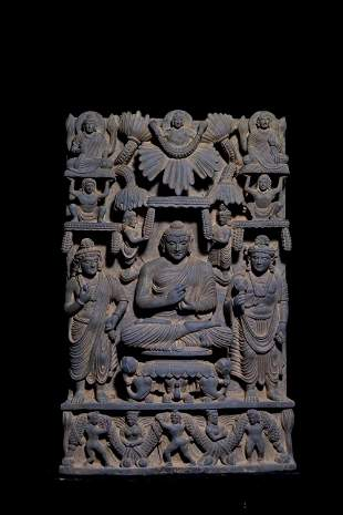 A CARVED LIME STONE BUDDHAS