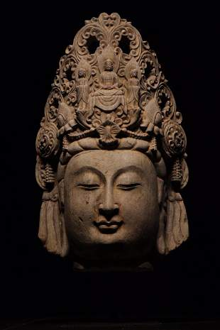 A CARVED LIME STONE GUANYIN HEAD