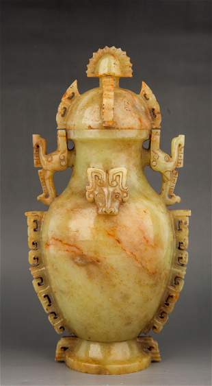 A CARVED JADE VASE AND COVER
