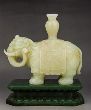 A CARVED WHITE JADE ELEPHANT AND SPINACH JADE STAND