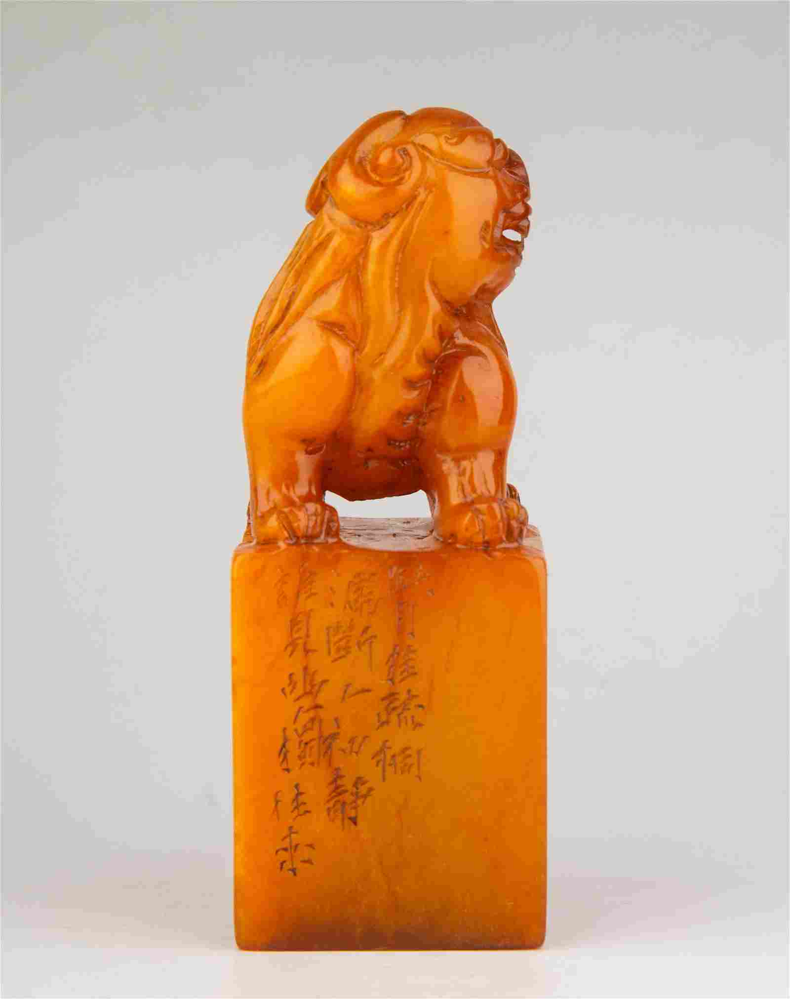 A CARVED SOAPSTONE 'LION' SEAL