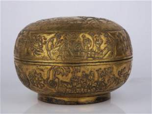 A CARVED GILT-BRONZE BOX AND COVER.