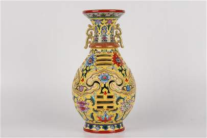 A YELLOW-GROUND FAMILLE-ROSE VASE.MARK OF QIANLONG