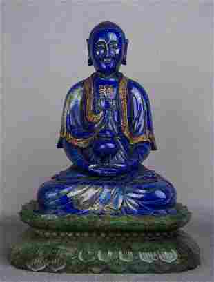 A CARVED LAPIS LAZULI BUDDHA AND SPINACH JADE STAND