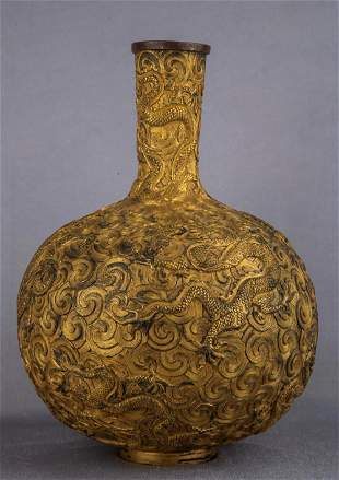 A CARVED GILT-BRONZE 'DRAGON' BOTTLE VASE.MARK OF