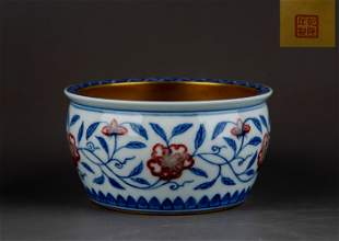AN IRON-RED BLUE AND WHITE WASHER.MARK OF QIANLONG