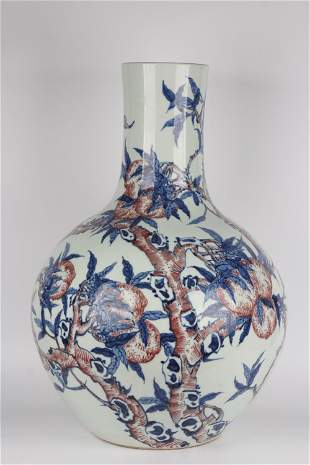 AN IRON-RED BLUE AND WHITE BOTTLE VASE.MARK OF