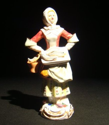 19: A Meissen porcelain figure of a female fishmonger