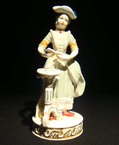 21: A Meissen porcelain figure of a lace lady