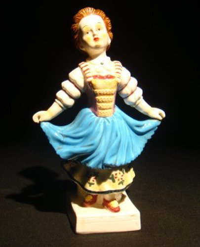 22: A Meissen porcelain figure of a  lady
