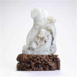 A Carved White Jade Arhat Boulder