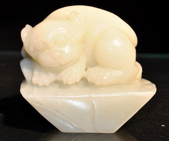 22: A WHITE JADE CARVING OF A LION.