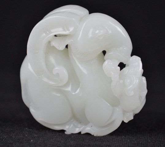 22: A WHITE JADE CARVING OF A RAM. (19CENTURY)