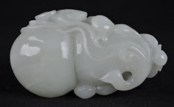 24: A FINE WHITE JADE CARVING OF A DOUBLE GOURD.(QING D