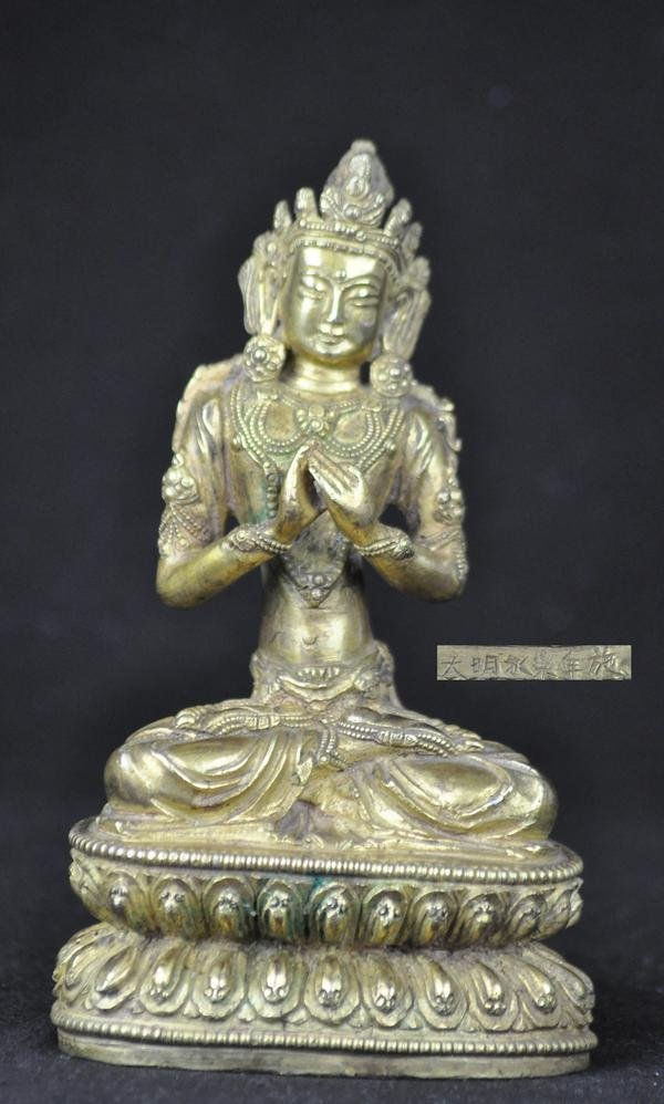 1: A GILT BRONZE FIGURE OF MANJUSRI, (YONGLE MARK MING