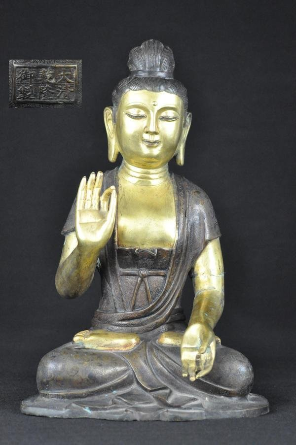 1: A VERY RARE AND IMPORTANT GILT-BRONZE FIGURE OF A SE