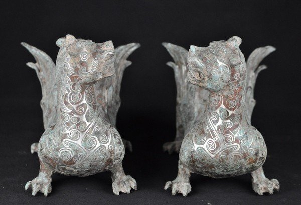 30: A PAIR OF SILVER INLAID BRONZE MYTHICAL BEAST.(HAN