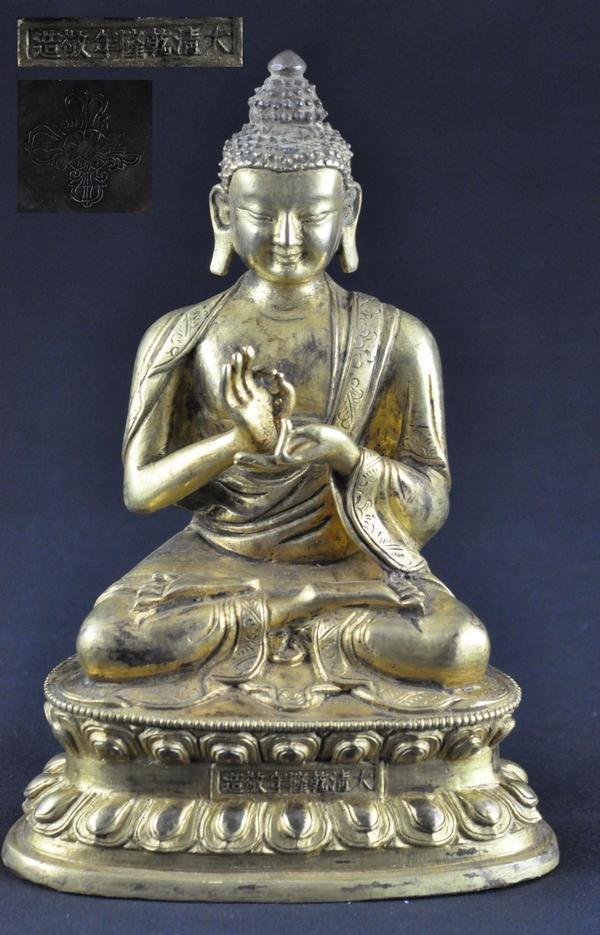 36: GILT BRONZE FIGURE OF BUDDHA .(QIAN LONG PERIOD)