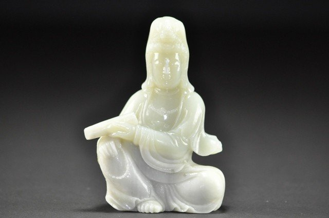 9: A WHITE JADE CARVING OF GUANYIN.