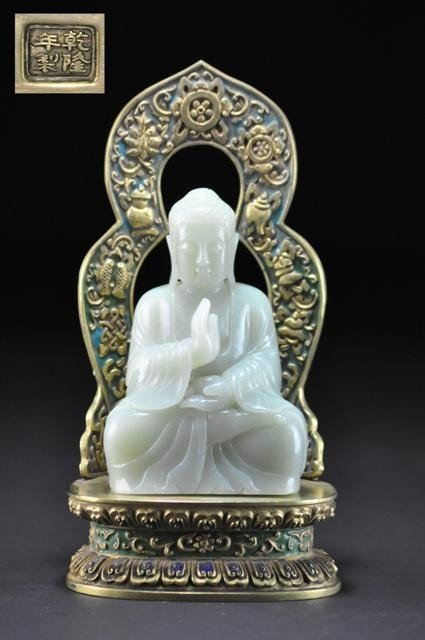 11: A RARE  WHITE JADE FIGURE OF BUDDHA .18TH CENTURY